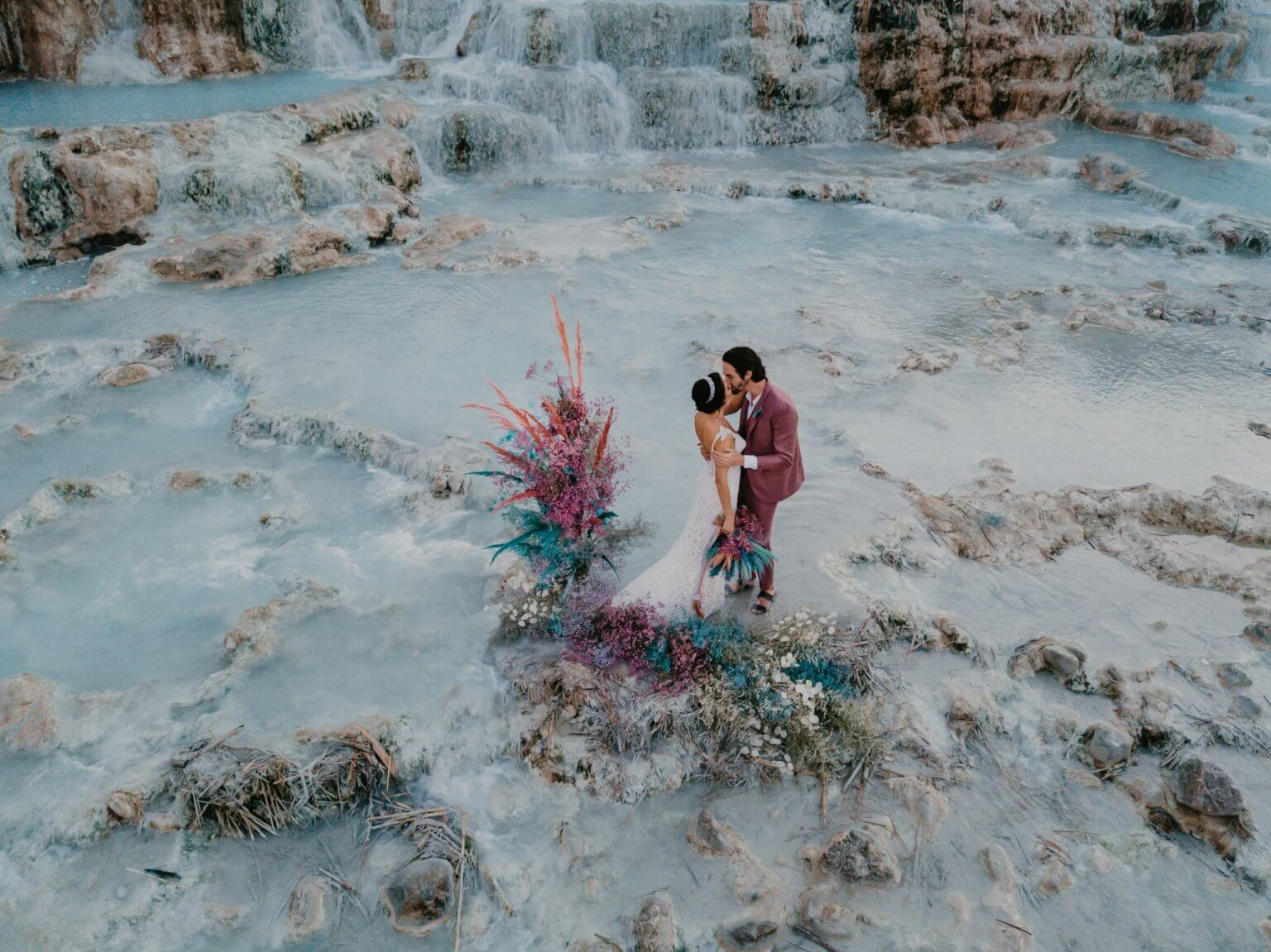Portray a couple in the middle of nature, exalting the background